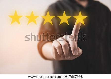 Customer review good rating concept hand pressing five star on visual screen and positive customer feedback testimonial Photo stock ©