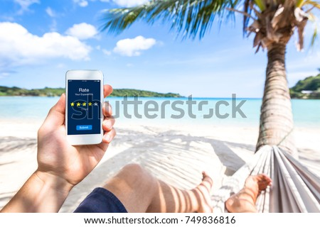 Customer review online app on smartphone screen asking user on the beach to rate experience and give feedback, satisfaction evaluation with star icons, digital marketing and quality management concept