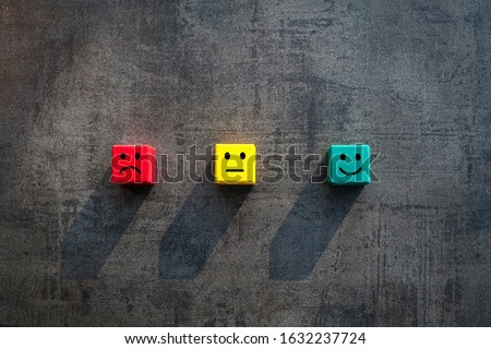 Customer satisfaction measurement unhappy okay and happy faces on coloured red yellow green wood blocks - Commercial business success client rating metrics scale - Excellence, KPI and feedback concept Photo stock ©