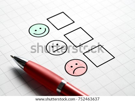 Customer satisfaction survey and questionnaire concept. Giving feedback with multiple choice form. Pen, paper and emotion smiley face icons. #752463637