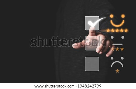 Customer satisfaction survey concept, Businessman touching smiley face icon with yellow five stars and correct mark to evaluate product and service. Foto stock ©