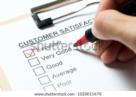 Customer satisfaction survey form on clipboard with red pen #1020015670