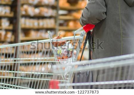 Customer select bread on shelves in supermarket