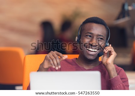Customer Service agent in an startup office with laptop