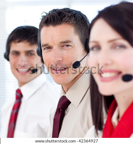 Customer service agents with headsets on in a call center