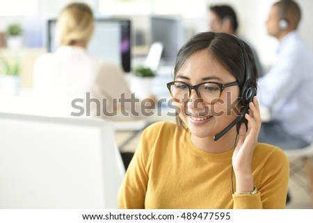 Customer service assistant working in office