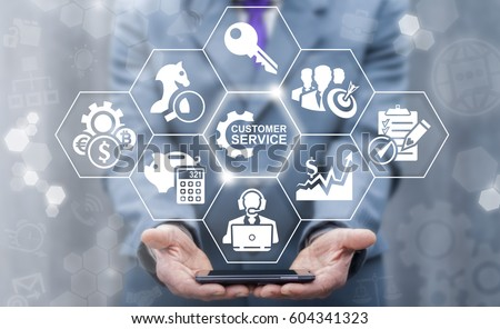 Customer Service Concept. Department Team Support Business. Businessman offers smart phone with customers services icon on virtual screen. Care Technology.