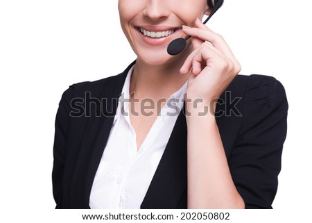 Customer service representative. Cropped image of beautiful young woman in headset smiling while isolated on white