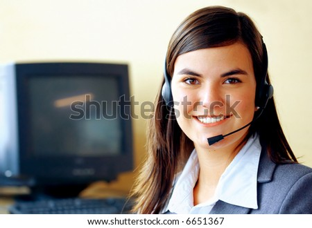 customer service representative in an office with a headset