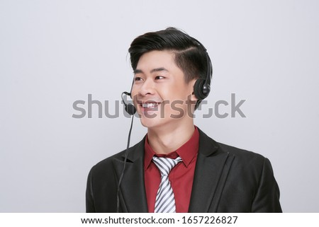 Customer service representative wearing a headset on white