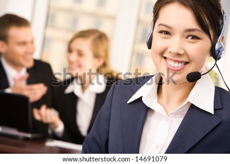 Customer service representative wearing headset looking at camera with smile