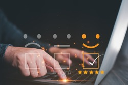 Customer service satisfaction survey concept.Business people or customers show satisfaction through the application on the tablet screen. By giving the most satisfaction rating and 5 stars.