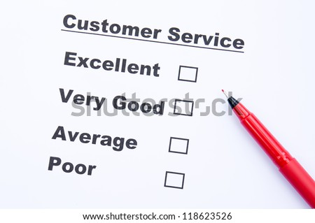 Customer service survey form and pen