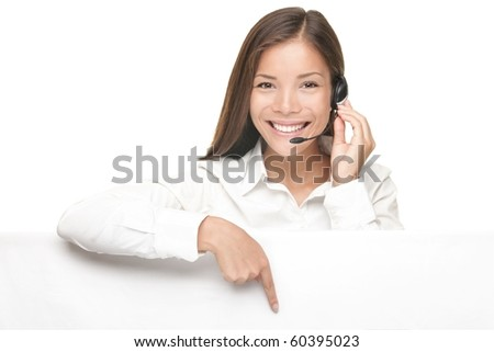 Customer Service woman with headset showing and pointing at blank billboard sign banner, Young smiling Chinese Asian / Caucasian female model.
