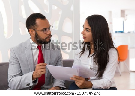 Customer showing documents to legal expert. Business woman giving papers to male colleagues in office lounge. Paper expertise concept #1507949276