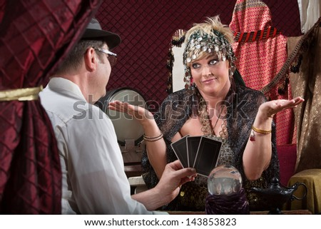 Customer showing happy tarot cards to fortune teller