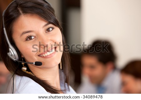 customer support operator smiling in an office