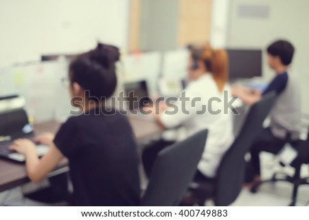 customer support service:blur officer working in headquarter center office room:staff training job career:blurry asian employee develop searching concept:worker learning studying satisfaction customer