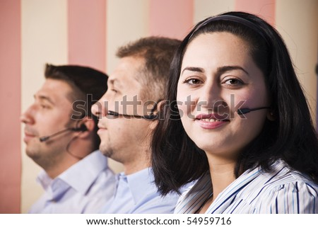 Customer support team close up ,focus on woman that smiling for you