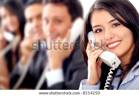 customer support team lead by a friendly girl smiling in an office