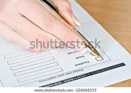 Customer Survey, hand girl pen notes excellent