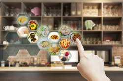 Customer use AR application to order food in restaurant, Hand touching virtual interface for order menu in restaurant, Augmented reality with electronic menu for restaurant.