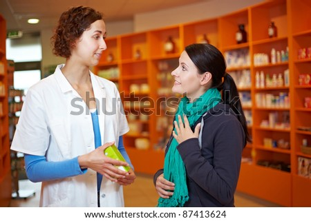 Customer with sore throat talking to pharmacist in a drugstore