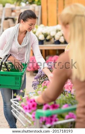 Customer woman shopping for flowers in garden center