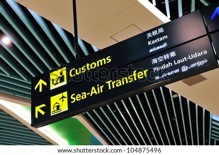 Customs and sea-air transfer signs in Marina Bay Cruise Center Singapore in 4 languages