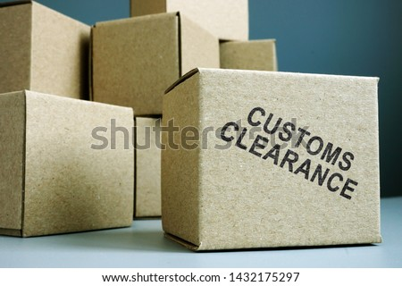 Customs clearance stamp on a side of box.