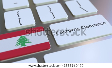 CUSTOMS CLEARANCE text and flag of Lebanon on the computer keyboard. Import or export related conceptual 3D rendering