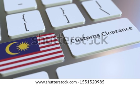 CUSTOMS CLEARANCE text and flag of Malaysia on the computer keyboard. Import or export related conceptual 3D rendering