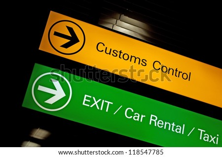 Customs control, exit, car rental and taxi sign at international airport.