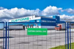 Customs logistic terminal with bonded warehouse. Cargo clearance and temporary storage services. Lorry are standing near the loading and unloading docks.