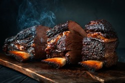 Cut a large piece of smoked beef brisket to the ribs with a dark crust. Classic Texas barbecue