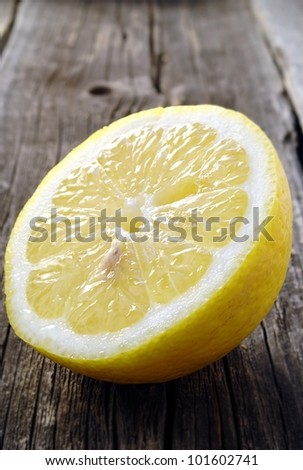 cut a lemon in an old dark board