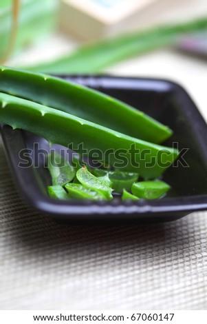 Cut aloe vera leaves in the black plate