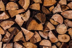 Cut and stacked dry woods. Pile of sawing woods.