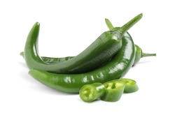 Cut and whole green hot chili peppers on white background