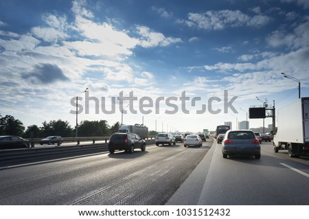cut asphalt layer on a road with cars. #1031512432