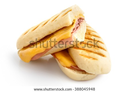Cut cheese and ham toasted panini melt with grill marks. Isolated on white. Stok fotoğraf ©