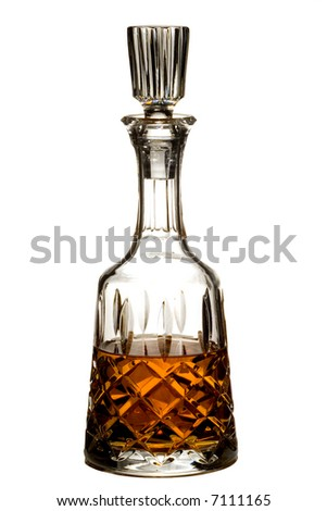 Cut crystal decanter of brandy or whiskey isolated on white