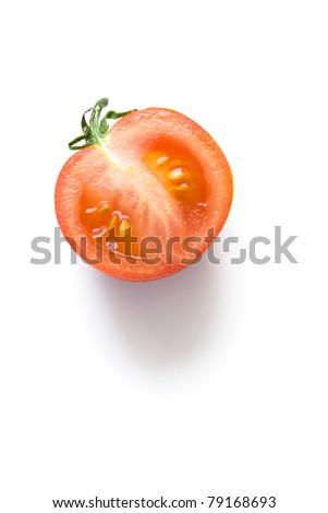 cut half tomato isolated on white background