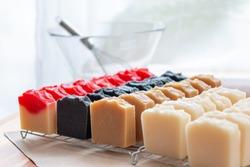 Cut Handmade Soap - Making Handmade Soap Inside the Soap Shop. Cut handmade soap on a table.