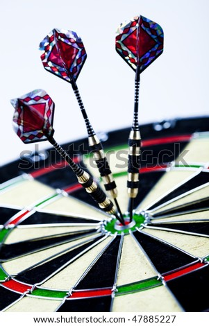 Cut image of dart pierced on target over dartboard - stock photo
