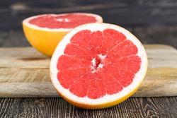 cut into pieces ripe orange red grapefruit, close - up of citrus