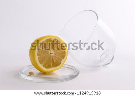 Cut lemon in glass bowl #1124915918
