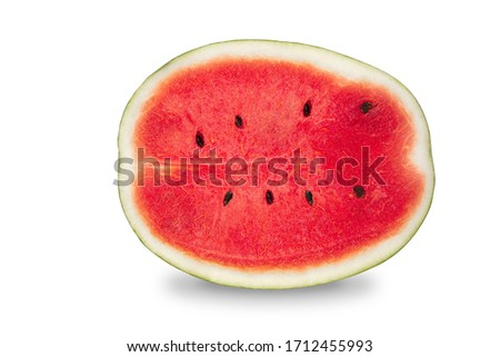 Cut lengthwise a half of organic watermelon on white isolated background with clipping path. Ripe red watermelon have sweet taste and juicy for refreshing in summer. Delicious fresh fruit concept. Zdjęcia stock ©