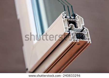 Cut of the window profile with metal, glass and insulation #240833296