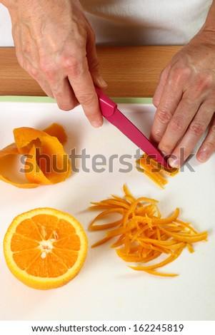Cut orange peels into strips. Candied Orange Zest Cooking. Series.
